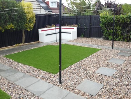 large back garden with astro turf, slabbing steps and gravel