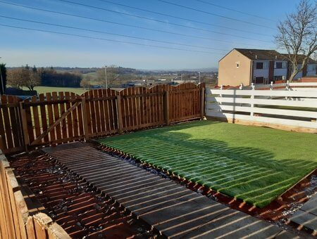 large front garden with new fence and gat