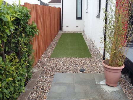 small side garden with artificial grass, gravel and slabbing