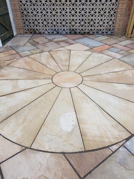 circular patio design with Fairstone Sawn Versuro Linear Paving Slabs
